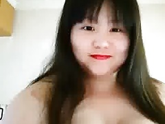 Beamy Chinese whore bringing off fro her tits 2